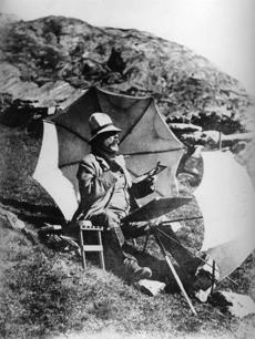 A photograph of Sargent (1856-1925) at work outdoors.